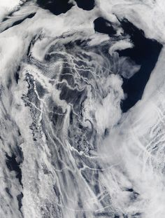 The beautiful clouds in this pictures is the result of vapor exhaust from ship engines. These clouds form when water vapor condenses onto particles in the exhaust, which act as seeds for the clouds.