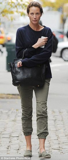 Bare-faced chic: Earlier, 45-year-old Christy was spotted strolling around New York withou...