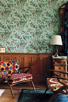 "The Inge Chair from Anthropologie ... ""We took a Danish midcentury modern silhouette–found by our buyers at the Brimfield flea market–and upholstered it in vintage suzani textiles, for an entirely unique, one-of-a-kind, heirloom piece."""
