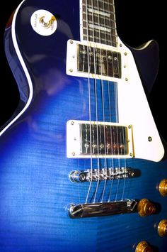 A blue electric guitar by scottsnyde
