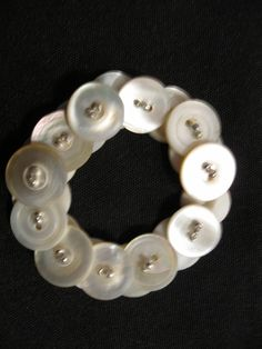 A personal favorite from my Etsy shop https://www.etsy.com/listing/172794464/vintage-button-bracelet-10mm-mother-of