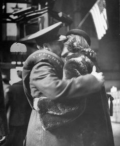 Couples sharing a last kiss before wartime departure, 1943. (Photo by Alfred Eisenstaedt)