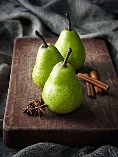 green pears wood cutting board cinn sticks rustic fruit photography