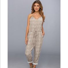 "NWT FREE PEOPLE Beige Criss-Cross Back Jumpsuit L FREE PEOPLE Beige Printed Criss-Cross Back Jumpsuit / size Large/ please view the size chart in top of closet for proper measuring.   Free People brand offers bohemian luxury apparel and accessories for a free spirited  lady!  Color: Stone Combo, Retail: $148.00, New with tags, Jumpsuit, V-Neck, Spaghetti Strap, Tie Closure, Waist Across: 19 1/2 "", Inseam: 29"", Rise: 15"", Material: 100% Rayon, Style #F296P036- this is gorgeous!! Free People…"