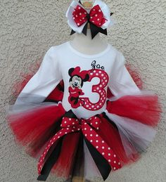 Need a tutu outfit quick, without rush fees? We now have a new line of Quick Ship tutu sets.    What little girl doesn't love Minnie Mouse? This precious outfit is perfect for Birthdays, portraits, parties, Halloween, Disney World vacations, etc.  Such a classic and timeless (and fabulous) outfit!  This adorable minnie mouse red and black tutu set has a sewn Minnie Mouse face appliqued on a delightful tee shirt ready for any celebration.