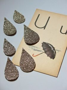 Glittery raindrops would be fun decorations for a pretty springtime tea party.sharp, but they would be easy as pie to recreate, I think! Fun Crafts, Paper Crafts, Paper Art, Alphabet Cards, Make It Rain, No Rain, April Showers, All That Glitters, Rain Drops