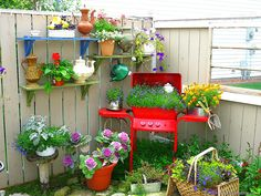 Spray paint an old barbeque red and turn it into a planter.