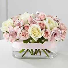 Blush and white roses, pale pink alstroemeria.