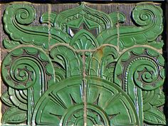 Detail, 7th Street Hotel, Chicago, Illinoisby Terence Faircloth Green terra cotta detail. From Flickr:  Detail of Art Deco ornamentation on the 7th Street Hotel in the South Loop area of Chicago, Illinois.