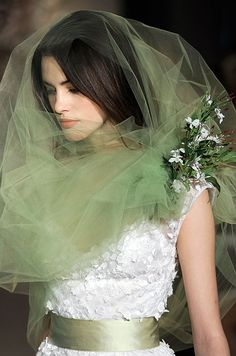For something truly unique, accent a white dress with a colored veil and matching belt.