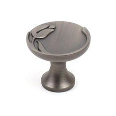 This antique pewter hand polished finish round cabinet knob with tulip insignia design is a part of the Tulip Series from Century Hardware. A perfect blend of craftsmanship in traditional and contemporary design to complement any decor.