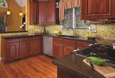 Kitchen Renovations from Granite Transformations of Northeast Ohio. Superior granite countertops and mosaic backsplashes.