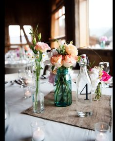 Gorgeous use of hessian and bottles for centrepiece