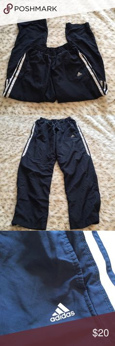 Adidas Track Pants Size small Adidas blue and white Track Pants! Zips near the ankle! This is the crinkly material style Track Pants! Worn a few times great condition Adidas Pants