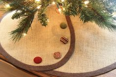 Narrow, Pencil Christmas tree skirt for all those slim spots: Apartment living, the Christmas buffet table, the entry foyer, the guest room or bedroom, etc. 30-inch diameter. Tailored for fit a slim pencil tree or tabletop tree. Timeless and tailored from my premium jute -- almost