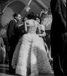 Debutante Marilyn Lowe wearing a dress made from feathers during the debutante cotillion.