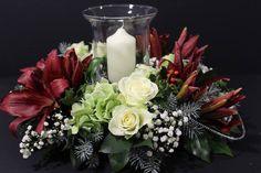 Glass candle floral arrangement. Via Fusion Flowers magazine.