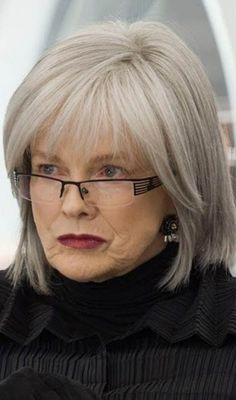 Hairstyles For Women Over 50 - Straight Silver Bob With Fringes