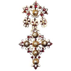 An antique yellow gold pearl and garnet cross pendant. Sicily, XVIII century. In a later old fitted box, c 1780