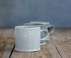 This is the mug you will have to drink your morning coffee with!  Light blue porcelain coffee mug in a great size for coffee lovers, adorned with geometric pattern in modern design. This modern porcelain tea cup for your evening herbal tea. Perfect for a cozy snuggle on the couch or in bed with espresso or hot chocolate. Made of folded porcelain sheets stamped with geometric pattern. Dipped in blue - gray glaze, burned to high temperature.  > 3 tall. 3 diameter / 8 cm tall, 8 cm diame...