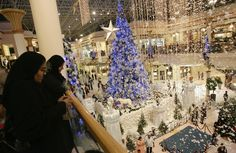 Emirati women look at Christmas decorations at one of Dubai's main shopping malls.   - HouseBeautiful.com