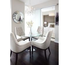 Classy All White Dining Room with Round Glass Table