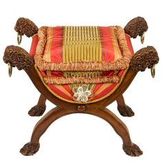 Regency Era Curule Bench with Carved Lion's Heads   From a unique collection of antique and modern benches at https://www.1stdibs.com/furniture/seating/benches/