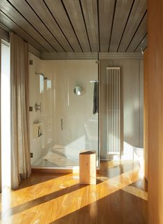 The IT CABIN kit house by IT HOUSE. Entire bathroom wall is glass. Makes it easier to see when inside that tiny wet bath, and cleaning should be easy.