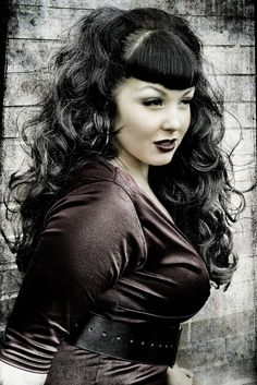 Black Long Loose Curls.  If i could pic one person in the world to be it would be her.  She is gorgeous, confident, curvy (not anorexic) and a superhero,  Classic pinup!!!
