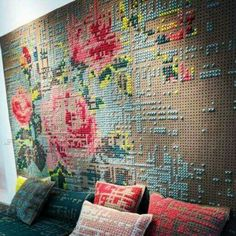 A large pegboard section with cross stitched yarn created this wall! Really brilliant!