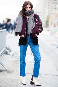 Oversized scarf + varsity jacket + mom jeans + white ankle boots
