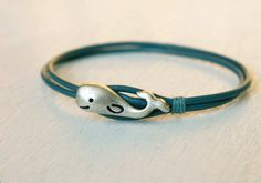 Whale Leather Bracelet  ( Etsy:: http://www.etsy.com/listing/91194818/whale-leather-bracelet-13-colors-of?ref=shop_home_active )