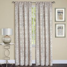The Madison Single Curtain Panel is elegant and room darkening.A stunning printed jacquard pattern on elegantly draping fabric.Rod pocket curtain panel drapes beautifully and can be hung on a decorative rod or with clip hooks.100% polyester fabric is machine washable.Image shows two panels, each panel sold separately.