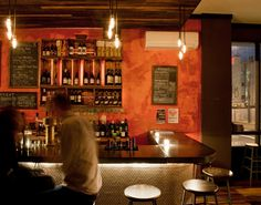 I like the wine wall color mixed with the rustic wood ceiling & the finish of the painted rust wall.
