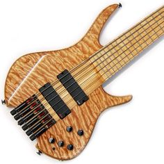 """#shuker series 2 #headless through #neck #bass . 34"""" scale, 24 #frets , 54mm nut width, 18mm string spacing, 20.5mm neck depth at 1st fret, 22.5mm at 12th. Laminated #maple and black veneer neck, #Birdseye maple #fretboard , two way truss rods, carbon fibre reinforcement. 5A #quilted maple drop top, white ash #body , polyester basecoat, wet look gloss topcoat. #EMG extended #pickups , shuker 3 band eq, #ABM individual tuner bridges, black hardware. #bassplayersunited #bassplayunited…"""
