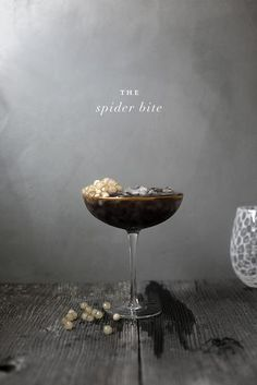 halloween horror inspired cocktails by kelli hall: Spider bite black russian with tapioca pearl spider sac garnish Easy Halloween Cocktails, Fall Cocktails, Cocktail Drinks, Cocktail Recipes, Alcoholic Drinks, Beverages, Cocktail Garnish, Cocktail Ideas, Drinks Alcohol