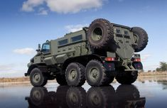 Heavily armored off-road vehicle. Russian URAL truck modified into MRAP for… Cool Trucks, Big Trucks, Pickup Trucks, Cool Cars, Army Vehicles, Armored Vehicles, Armored Car, Armoured Personnel Carrier, Bug Out Vehicle