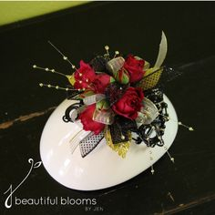 Red wrist corsage with gold and black accents on a black beaded keepsake bracelet by Beautiful Blooms by Jen.