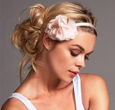 not much of a flower in the hair person, for myself..but love the messy bun look.