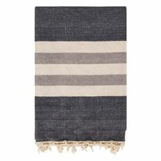 "Perfect folded at the foot of your bed or draped over an arm chair, this cozy fringed cotton throw showcases a bold stripe motif.   Product: ThrowConstruction Material: 100% CottonColor: GrayFeatures: Fringed edgeDimensions: 50"" x 70"""