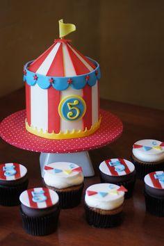 Circus tent birthday smash cake with matching cupcakes