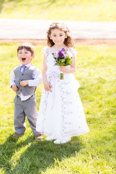 Flower girl in white embroidered dress + petite purple bouquet and ring bearer in gray suit + purple tie - adorable! {Anne Lee Photography}