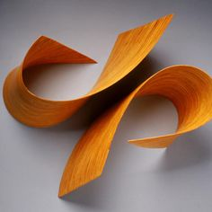 "Sculptor Nancy Sansom Reynolds fashions colorful wood sculptures that appear to bend and flex at her whim. However, Reynolds has had to combine her artistic senses with mathematics and carpentry - drawing shapes. Reynolds exhibits in New York, California, Arizona, and Washington, DC. In 2002, her work appeared in the exhibition ""Curator's Choice"" at the Corcoran Museum of Art in Washington, DC...made with laminated and carved plywoods."