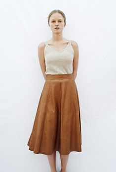 Love this 1970s inspired look with the aline camel colored skirt and simple tank