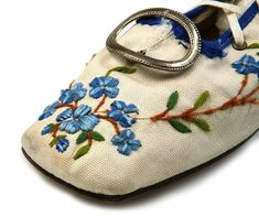 1865 Lady's canvas pumps with very high back lacing through seven metal eyelets. Decorated with embroidery. Low knock on heel. 1860-65 http://eng.shoe-icons.com/collection/object.htm?id=1590