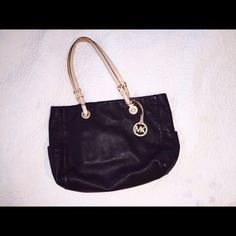 Authentic MK tote - dark brown This is a tote I'm reposhing. It's a dark chocolate brown in colors handles are worn, bag in good condition, inside needs a cleaning.  Willing to trade. Michael Kors Bags Totes