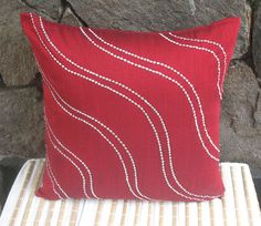 red throw pillow w/ silver wave embroidery 16 inch