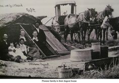 A Pioneer family and their dugout.  A dugout is a hole or depression dug into the ground. Dugouts can be fully recessed into the earth, with a flat roof covered by ground, or dug into a hillside.