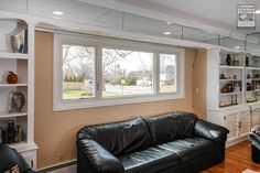 Another great triple combination we installed, this time with two casements and a picture window in this modern living room in Nassau County...