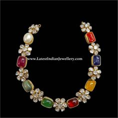 Elegant navratna necklace in single line design holding 9 large precious stones separated by polki flowers sits around the neckline with grace. Jewelry Design Earrings, Ruby Jewelry, Gold Jewellery Design, Necklace Designs, Pendant Jewelry, Bridal Jewelry, Gemstone Jewelry, Beaded Jewelry, Gold Jewelry